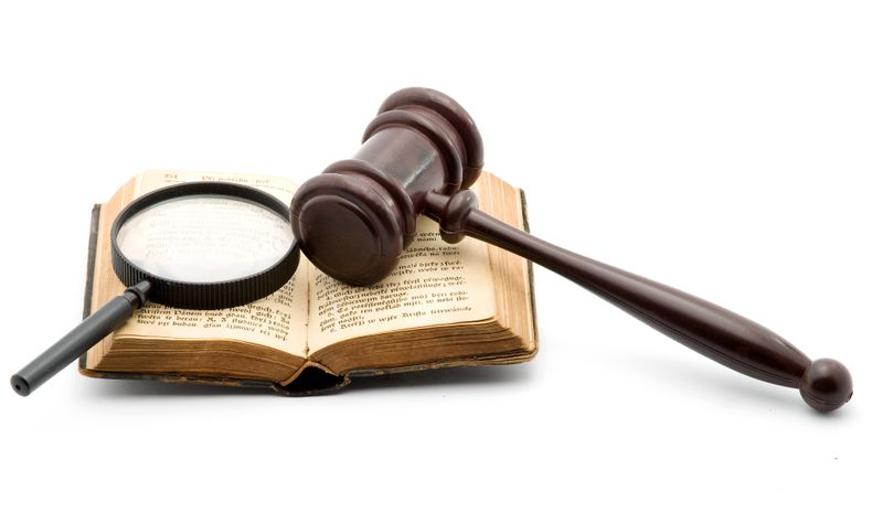 Gavel and magnifier photoxpress
